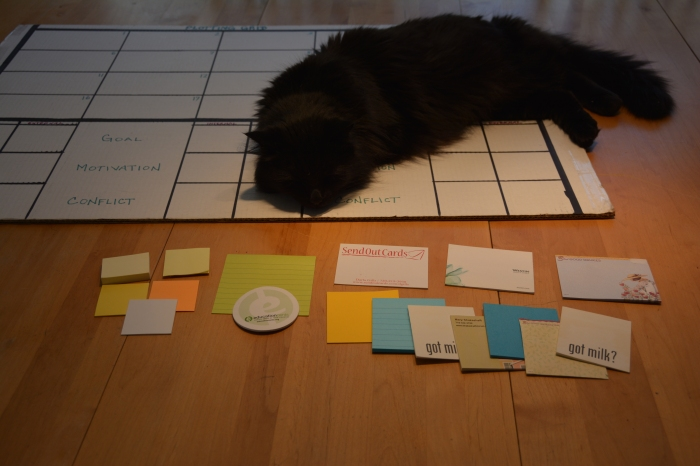 "photo of feline companion ""helping"" with the plotting grid"